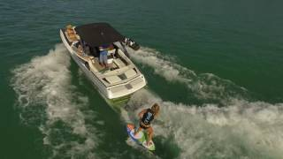 Late summer surf session on Walloon Lake with #Tommy's behind a Malibu WakeSetter 22 MXZ! Aerial footage of Walloon Lake, Village Marina, Barrel Back Restaur...