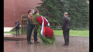 Heavy rain brakes out as Russian President lays a wreath at the Tomb of the Unknown Soldier during anniversary ceremony...
