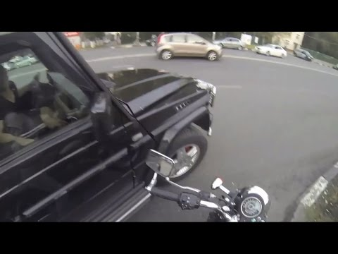Watch Russian motorcyclist punishes litterbugs