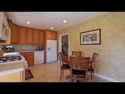 A split-level Elmhurst home with a great deck and yard