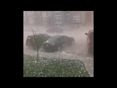 Hail pummels cars