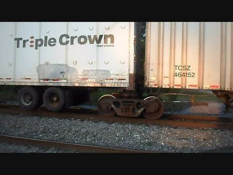 Norfolk Southern Train Pulling Triple Crown Trailer Trucks Over Bad Tracks