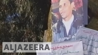 Tunisia: Protests erupt after fruit seller sets himself on fire Riot police in Tunisia confronted protesters who took to the streets after a fruit seller set...