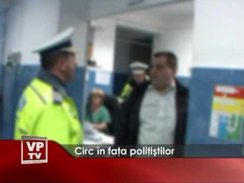 Circ în faţa poliţiştilor