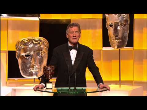 Palin - Michael Palin receives Bafta Fellowship Award from fellow Monty Python member Terry Jones.