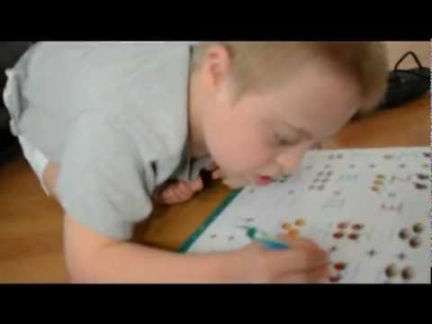 Watch video Down Syndrome doing maths