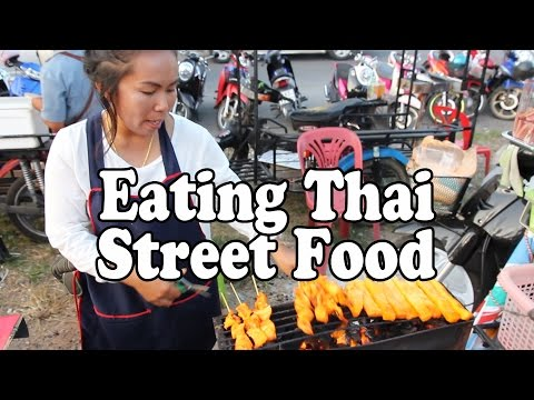 Thai Street Food. Shopping for and eating my favorite street food at a market in Thailand.
