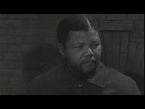 Reporter - This is Nelson Mandela's first television interview from 1961 when he was a young activist in the ANC party. . Report by Online Freelancer.