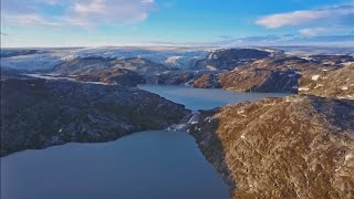 Scientists working in Greenland. The video describes the study's findings, showing that Greenland's ice loss rates in the 21st century could starkly outpace that of all prior centuries over the past 12,000 years.
