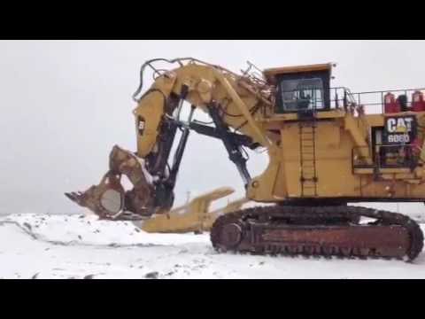 CATERPILLAR PELLE MINIERE EN BUTTE 6060FS equipment video XugYlRBczXE