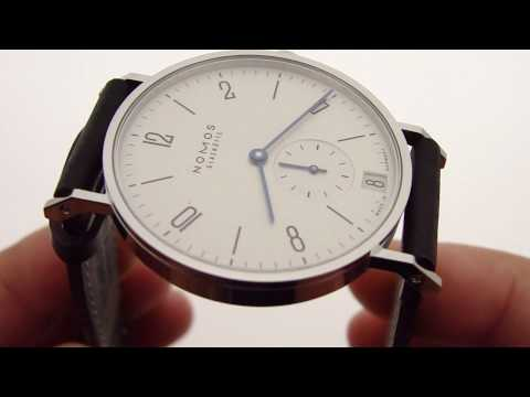 keepthetime - Buy this watch at http://KeepTheTime.com * Nomos Glashutte Tangente Datum (ref 130) in new condition, unworn * Automatic self-winding mechanical movement o M...