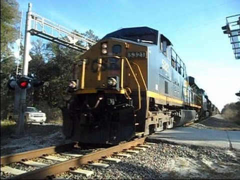 CSX locomotive - This is the longest freight train I have ever recorded near my home town. It has 7 locomotives and 123 cars. At the location where I was filming it started p...