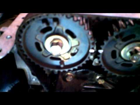 Timing belt replacement 2000 Mazda Protege DOHC 1.6L water pump Install Remove Replace