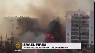 fires rage across israel    ইসরাইলের উপর আল্লাহর গজব ২০১৯ #Aljazeeranews