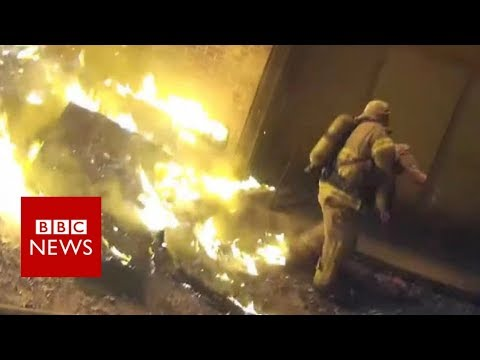 Miracle catch: Firefighter catches child from burning building - BBC News (видео)