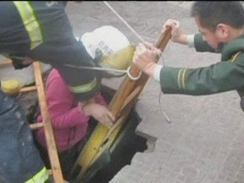 China - Teenager Disappears Into Sinkhole