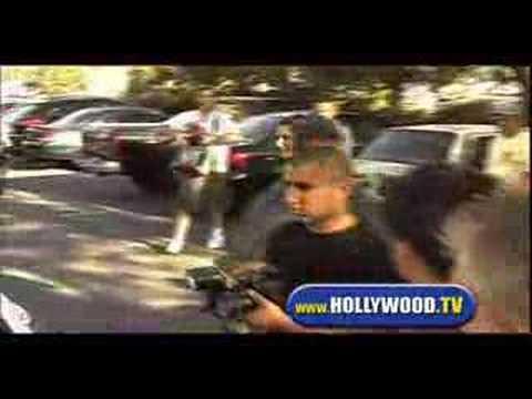 Pedestrian Throws Coffee at Paparazzi Mob