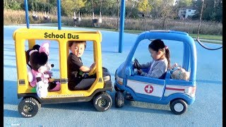 Riding School Bus and Ambulance Ride On Cars at the Playground