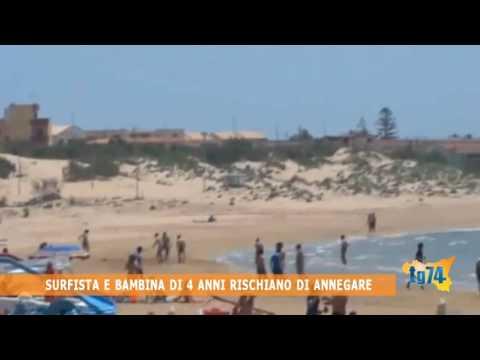 Surfista e bambina di 4 anni rischiano di annegare
