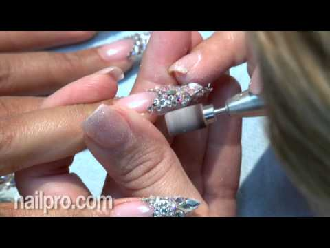 swarovski - Nail artist Gina Silvestro created stunning sparkling tips with gel and real Swarovski crystals for the December 2012 NAILPRO cover. http://www.nailpro.com.