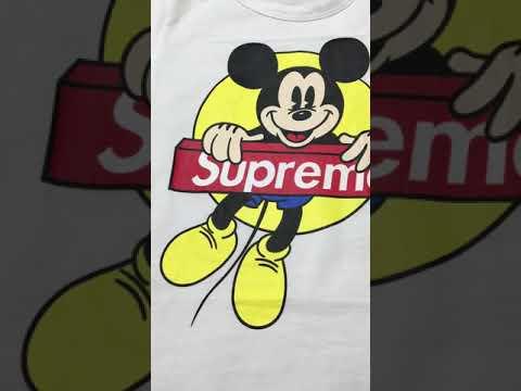 Фирменный комплект из футболки белого и шорт черного цвета видео