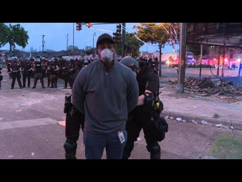 News crew arrested on air in while covering riots