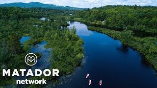 In the center of New York's Adirondacks, you'll find Long Lake—a 14-mile widening in the 140-mile-long Raquette River—and the ...