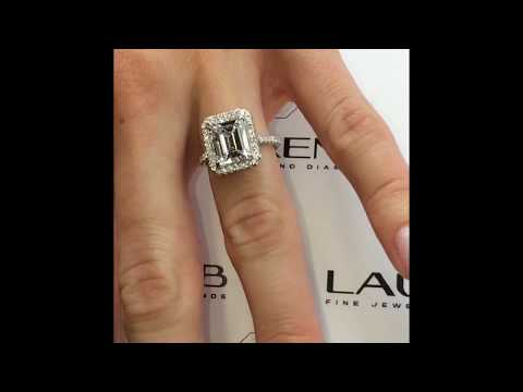 4 Carat Emerald Cut Diamond Ring in Cathedral Halo
