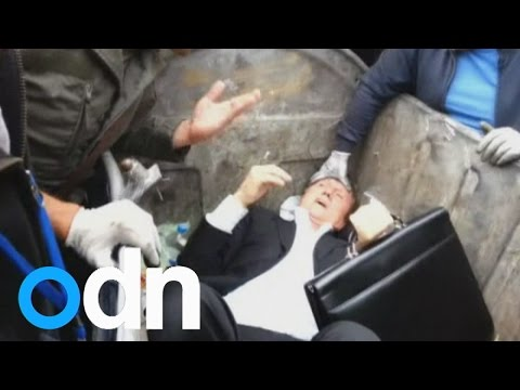 bin - Subscribe here: http://bit.ly/ODNsubs An angry mob has thrown a Ukrainian MP into a rubbish bin outside the country's parliament in Kiev. A group of men were filmed shoving and pushing Vitaly...