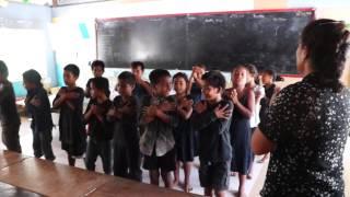 Schookids from the Poland village (Kiritimati) sing the anthem of Christmas Island.
