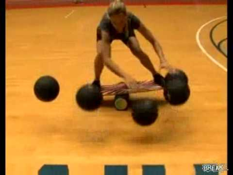 Some Chick Dribbles Bajillion Basketballs While On A Balance Board.