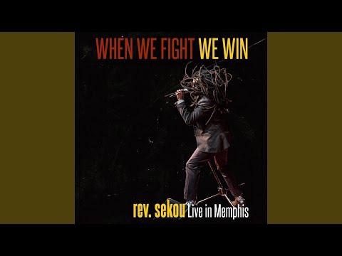 We Comin' online metal music video by REV. SEKOU