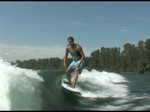 Lance riding behind a Centurion on Inland Surfer Blue Lake board