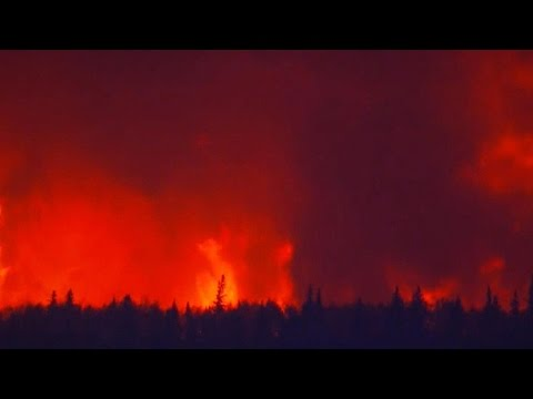 Unstoppable wildfires burn hundreds of Canadian homes