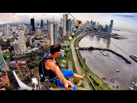 Guys ride the largest urban zipline in the world