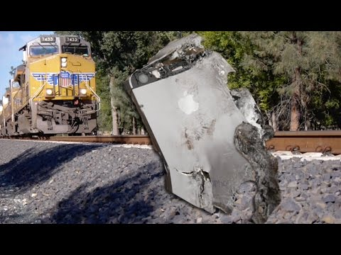 it - See what happens in this test when a full blown train runs over the iPhone 5S...twice! FACEBOOK: https://www.facebook.com/pages/TechRax/192119757502890 TWITTER: https://twitter.com/TechRax...
