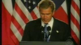 During a press conference, President George W. Bush emphatically references his visit to Africa.