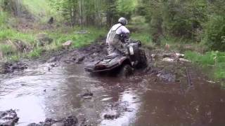 4. Arctic Cat 700 Diesel, Bombardier Outlander 400, Deep in the mud.