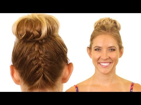 upside down french braid - http://www.rolfssalon.com - Top knots are still one of the top hair trends for 2012. We've added a bit of flair to the normal top knot by combining an upside...