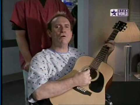 It's been 15 years since Colin Hay performed Overkill on Scrubs