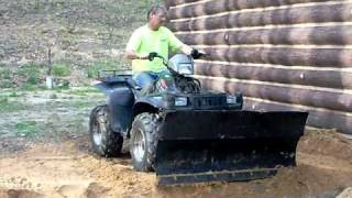 5. 2002 Polaris Sportsman 700 Twin 4x4 ATV of the Year, Plowing Dirt with the Polairs Plow