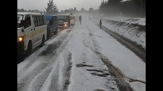 Snowing in Kenya.Nyahururu roads covered with snow and residents are amazed.
