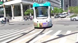 Detroit QLine LRV Moving From Curb Lane To Congress Centre Stop