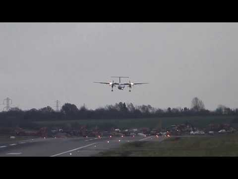 david - Brussels Airlines Dash 8 go around at BHX due to high winds. Thursday 5 December 2013 Other videos taken on the same day Emirates 777 -- First approach and g...