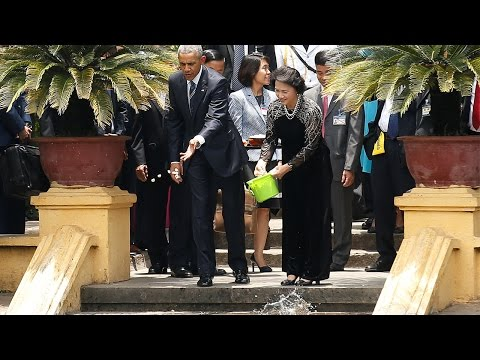US President Barack Obama feeds fish at the presidential palace in Hanoi.