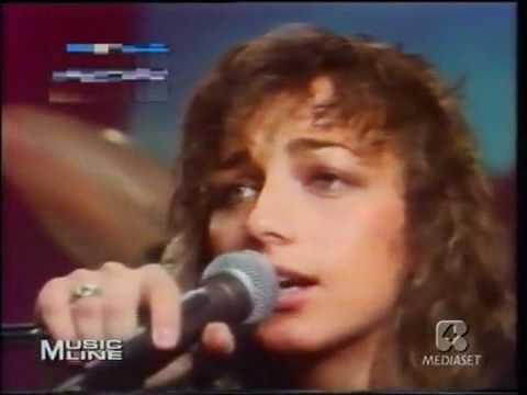 Tekst piosenki Gianna Nannini - 5 Minuti po polsku