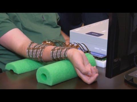 Paralyzed man regains hand movement