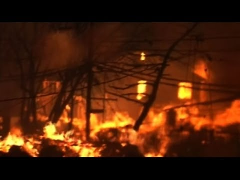 in queens - Firefighters were fighting early Tuesday to contain a blaze sparked after superstorm Sandy which has destroyed 50 homes in the New York borough of Queens. Du...
