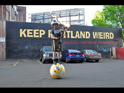 Man Plays Star Wars Theme Song on Flaming Bagpipes While Balancing on BB8 Droid