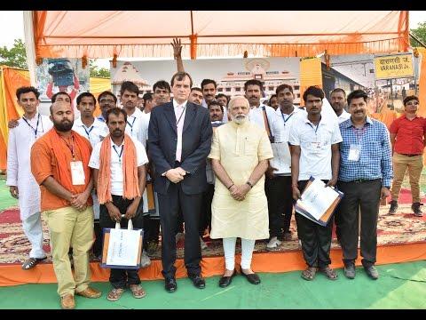 PM Modi distributes E-Rickshaws & interacts with beneficiaries in Varanasi